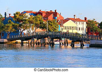 Long wooden bridge near the island of Mazzorbo in the venetian lagoon northen italy