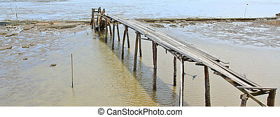 Wooden bridge in the sea.