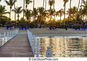 wooden bridge in the sea sunrise