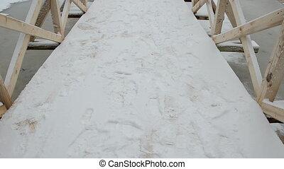 wooden bridge in the winter