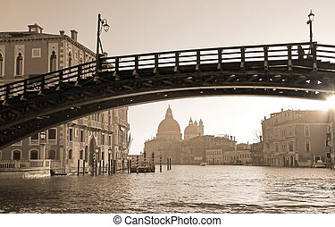 wooden bridge in Venice Italy called Ponte della Accademia with sepia toned