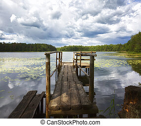 Wooden bridge on a forest lake