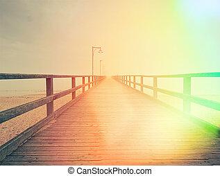 Wooden bridge on a sea dock. Pier on the coastline. Sea coast.