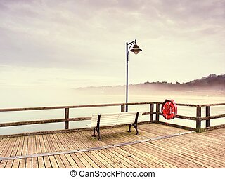 Wooden bridge on a sea dock. Pier on the coastline. Wooden bridge.