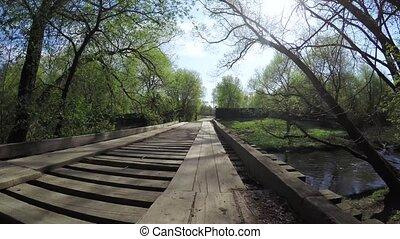 Wooden bridge on a small river