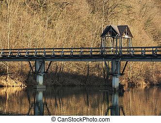 Wooden bridge on a water
