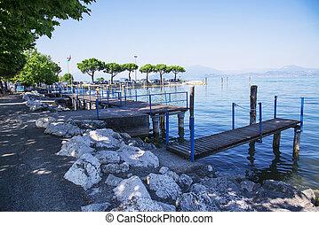 Wooden bridge on Lake Garda in Italy.