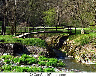 Wooden bridge on river Blanice, public park in city Vlasim, central bohemia region