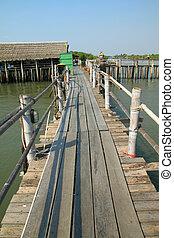 Wooden bridge on sea