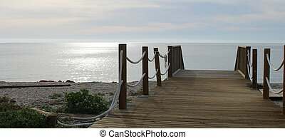Wooden bridge on the beach