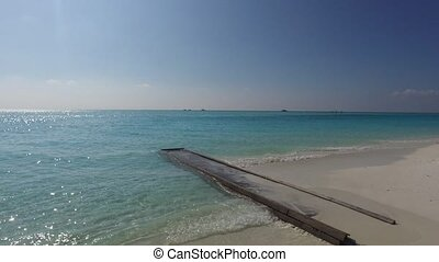 wooden bridge or pier in sea water on beach