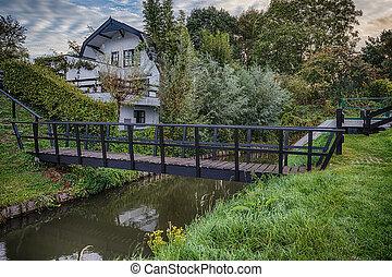 Wooden bridge over a ditch