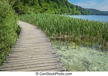 Wooden Bridge over a Lake in Plitvice National Park