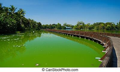 Wooden bridge over Kandawgyi lake in Yangon Myanmar