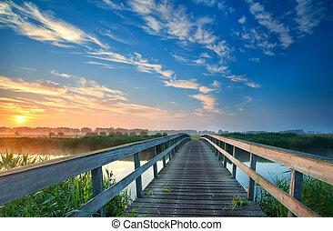 wooden bridge over river