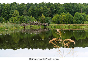 wooden bridge over the river, decorative wooden path on the lake