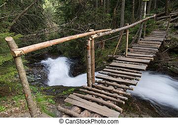 Wooden bridge over the river in Rhodope Mountain, Bulgaria