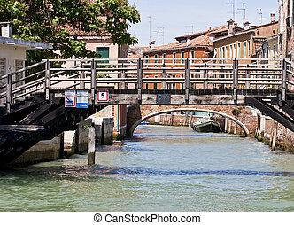Wooden Bridge Over Venice Canal