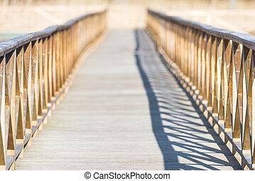 Wooden bridge over water with short depth of field