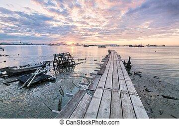 Wooden bridge sunrise in Clan Jetty
