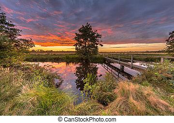 Wooden bridge sunset landscape