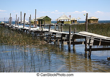 Wooden bridge to floating island
