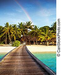 Wooden bridge to island beach resort, beautiful colorful ...