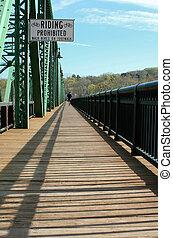 Wooden bridge walkway with lone jogger