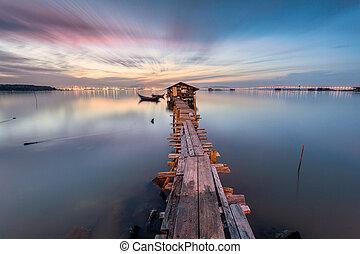 Wooden bridge with a hut sunrise