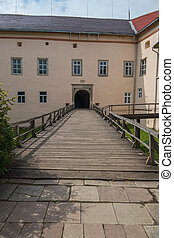 Wooden bridge with railing to the arch of the entrance to the castle. Transcarpathia Uzhhorod Ukraine