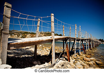 Wooden bridge with ropes over a river in Zakhyntos