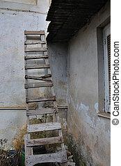 wooden broken ladder - Wooden broken ladder leaned against...