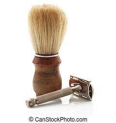 wooden brush with razor on white background