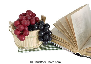 Wooden bucket and grape with book