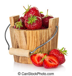 Wooden bucket of strawberry and pieces of fruit nearby,...
