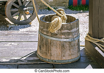 Wooden bucket on the well.