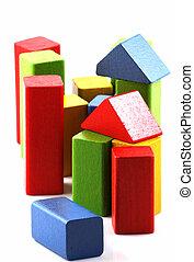 Wooden building blocks on white background