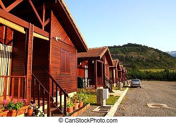 Wooden bungalow row campign camp park