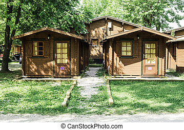Wooden bungalows on campsite camping