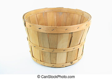 Still image of front view of wooden bushel over white background.