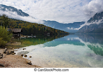 Wooden cabin at the border of Bohinj Lake in autumn