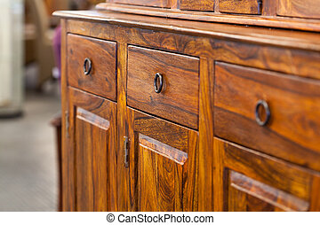 Wooden cabinet - A closeup od a dark brown wooden cabinet ...