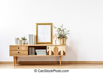 Wooden cabinet by empty wall