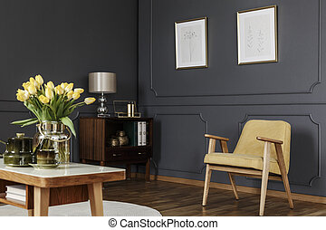 Wooden cabinet in the corner of a dark living room interior...