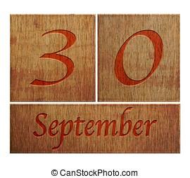 Wooden calendar September 30. - Illustration with a wooden...