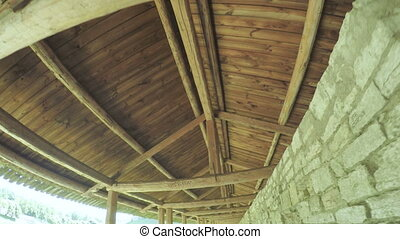 Wooden carport on castle wall - Steadicam camera on a wooden...