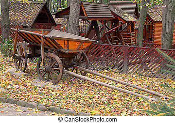 Wooden cart in the autumn park