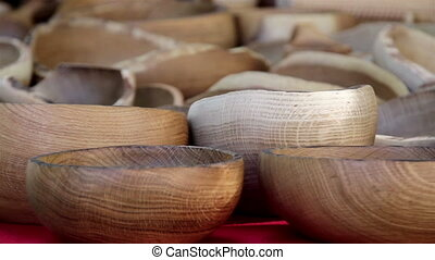 Wooden carved bowls all piled up. Hand carved wooden bowls...