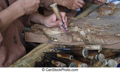 Wooden carving. - Hands of the craftsman wooden carving a...