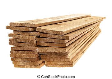 Wooden cedar boards piled - Stacks of one by six inch cedar...